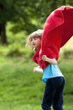 Boy Running Around in Red Towel Royalty Free Stock Photography