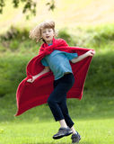 Boy Running Around in Red Towel Stock Photos
