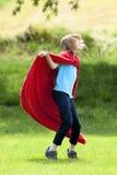 Boy Running Around in Red Towel. As Superhero Cloak Royalty Free Stock Photo