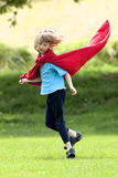 Boy Running Around in Red Towel Stock Image