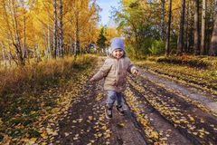 Boy running in the autumn forest Stock Photography