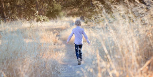 Boy running away Stock Image