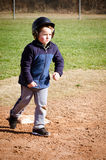 Boy running bases Stock Photos