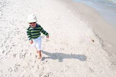 Boy running on beach. Small boy after beach running Royalty Free Stock Photo