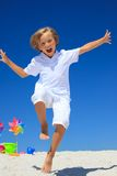 Boy running on beach Stock Images