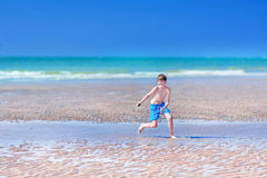 Boy running on a beach Royalty Free Stock Photography