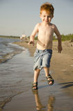 Boy running at the beach Royalty Free Stock Image