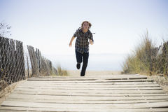 Boy Running On Beach Walkway Stock Images