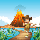 Boy running on the bridge with volcano background Royalty Free Stock Photos