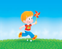 Boy running with a color wheel Royalty Free Stock Images