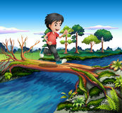 A boy running while crossing the river Royalty Free Stock Photography