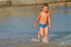 Boy running down the beach Royalty Free Stock Photo