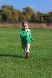 Boy running in field Stock Images