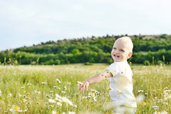 Boy running in field Stock Photos