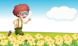A boy running in a floral field Stock Photography