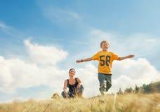 Boy running on golden field stock photo