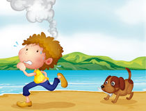 A boy running with his dog Royalty Free Stock Photo