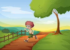 A boy running hurriedly at the farm Royalty Free Stock Photos
