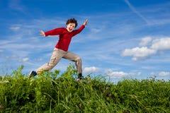 Boy running, jumping outdoor Stock Image