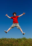 Boy running, jumping outdoor Stock Images