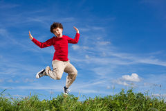 Boy running, jumping outdoor Royalty Free Stock Image