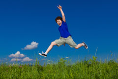 Boy running, jumping outdoor Stock Photography