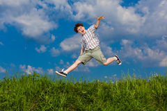 Boy running, jumping outdoor Stock Photos