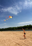 Boy running kite Stock Photography