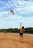 Boy running kite Royalty Free Stock Image
