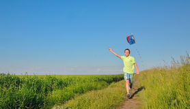 Boy  running with kite Royalty Free Stock Image