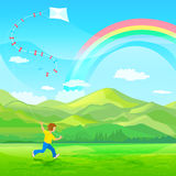 Boy running with a kite Stock Images