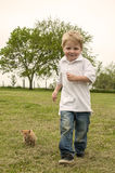 Boy running with kitten Stock Photography
