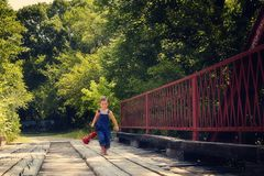 Boy running with lantern on red Royalty Free Stock Photography