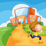 A boy running and a lion near the school Royalty Free Stock Photos