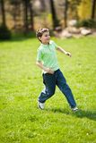 Boy running on a meadow Royalty Free Stock Image