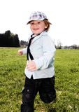 Boy running meadow royalty free stock photo