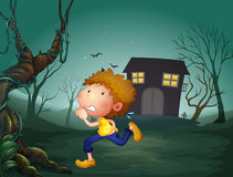 A boy running in the middle of the night Stock Photography