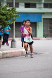 Boy is running in mini marathon Royalty Free Stock Photography