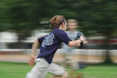 Boy running in motion royalty free stock images