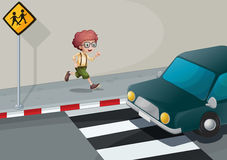 A boy running near the pedestrian lane Stock Photography