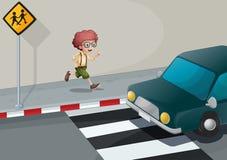 A boy running near the pedestrian lane Stock Photography
