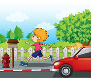 A boy running near the wooden mailbox Royalty Free Stock Images