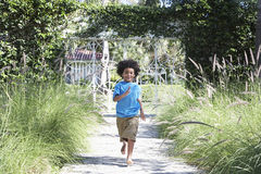 Free Boy Running On Path Royalty Free Stock Photography - 33917877