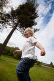 Boy Running Outside Stock Image