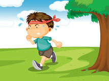 A boy running outside Stock Photography