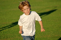 Boy running in the park stock photos