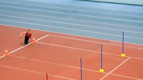 Boy running in the relay at the athletics training in sport school stock video