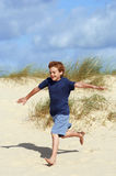 Boy Running On Sand At Beach Royalty Free Stock Photography