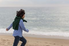 Boy running by the sea stock photo