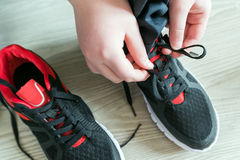 The boy running shoes  laces Royalty Free Stock Image